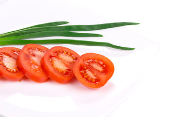Sliced tomato and spring onion.