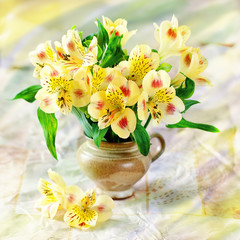 beautiful yellow flowers in a flower pot on a table.