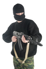 Man in black mask stands with AK-74 machine gun