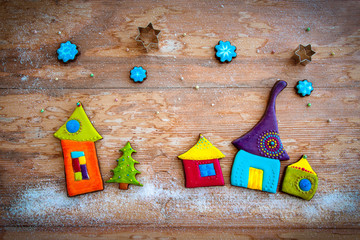 Sweet village. Colorful cookies on wooden background