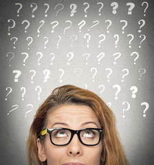 woman with puzzled face expression question marks above head