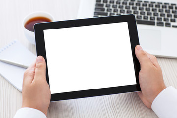 tablet with isolated screen in male hands over the table