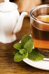 Teacup with fresh green tea