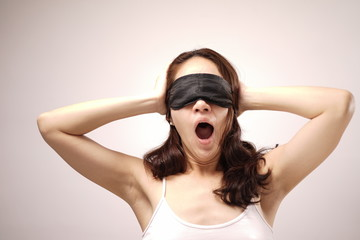 Asian chinese woman with her eye cover