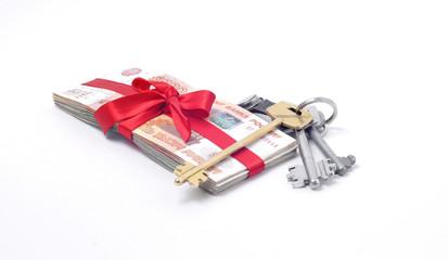 Стопка денег перевязанная красной лентой ключи от квартиры