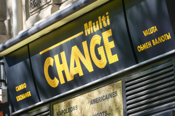 A multilingual sign of currency exchange point