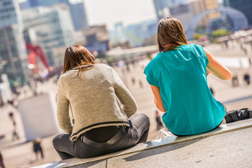 Two young ladies having outdoor lunch