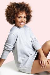 portrait of a pretty woman wearing grey sweatshirt