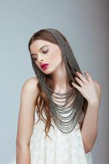 Glamor. Fashion Model with Fancy Headwear