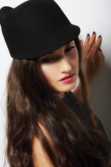 Vintage. Romantic Pensive Woman in Black Hat