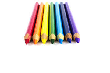 rainbow colored color pencils isolated over white
