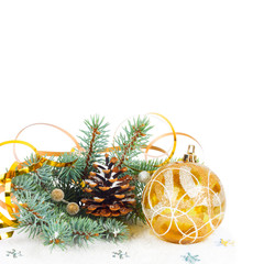 Christmas tree branch with gold serpentine and yellow sphere on