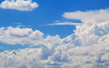 Cloudscape in sunlight with blue sky