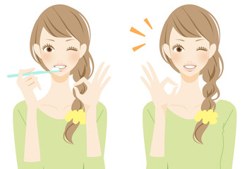 歯を磨く笑顔の女性 マル