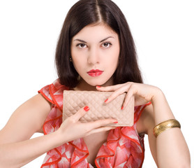 Beautiful young woman with clutch bag