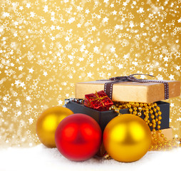Golden gift box with Christmas balls and garlands of beautiful b