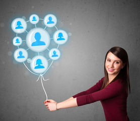 Woman holding social network balloon