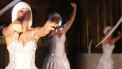 beautiful actress girl in white clothes dancing on the stage und