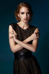 Beautiful girl in a black evening dress.