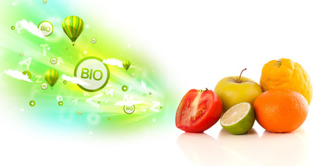 Colorful juicy fruits with green eco signs and icons