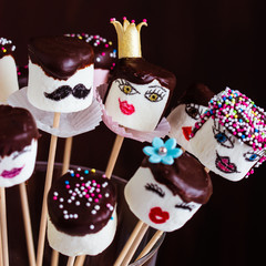 Funny marshmallow pops with chocolate and sugar decoration