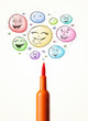 Smiley faces coming out of felt pen