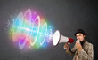 Man yells into a loudspeaker and colorful energy beam comes out