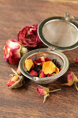 natural organic tea from dry roses on a wooden background