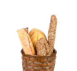Fresh crispy baguettes in basket.