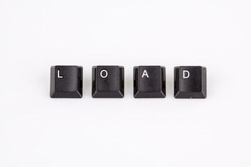 load word written with black computer buttons over white