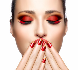 Beautiful Girl in Red with Hands on Her Face. Nail Art and Makeu