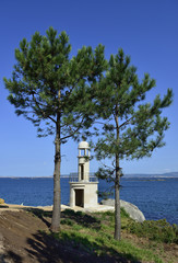 lighthouse in beautiful summer landscape of the Rias Baixas