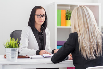 Business woman evaluating job candidate