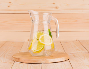 Colorful fresh lime and lemon fruit in carafe.