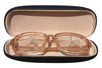Old broken glasses in a case isolated on white background.