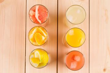 Lemonade orange and grapefruit juice on table.