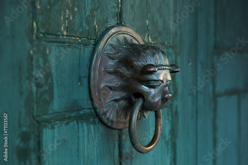 canvas print picture Antique door handle in the form of a lion