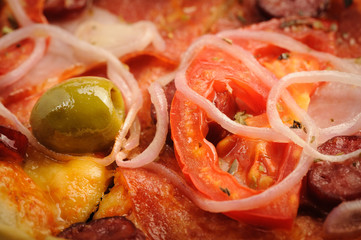 Pizza with tomato, salami, peppeeoni, olives and yellow hot