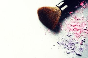 Makeup brush and crushed eyeshadows