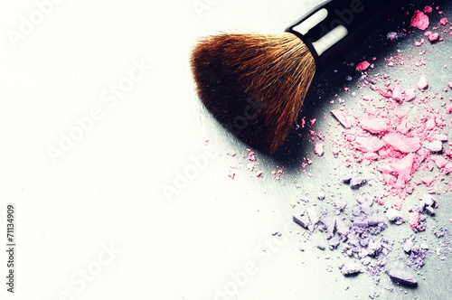 Makeup brush and crushed eyeshadows