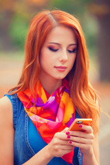 Beautifu girl with mobile phone in the park.
