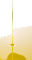 Pouring olive oil on white surface