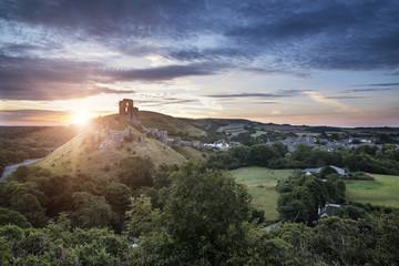 Castle ruins landscape at sunrise with inspirational sunburst be