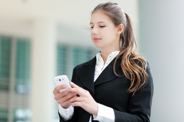 Business woman sending a sms
