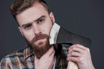 Shaving with axe.