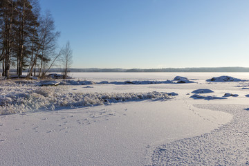 Frosty and snowy Lake Pyhäjärvi in Tampere, Finland in winter