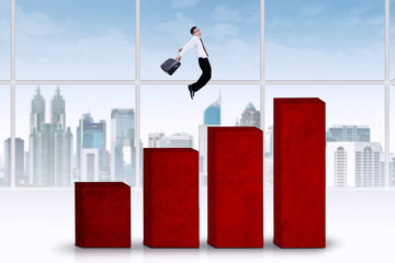 Businessman jumps above chart