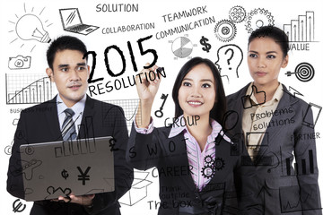 Businesspeople makes resolutions in 2015