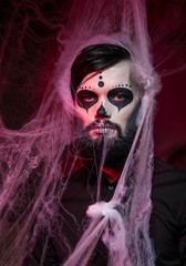 Halloween concept with young man in day of the dead