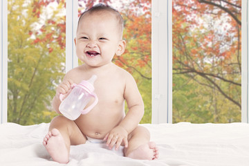 Funny baby girl on bedroom